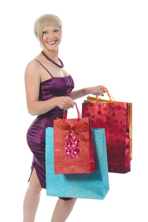 Pretty blond with shopping bags. Isolated on white background Stock Photo - 6970612