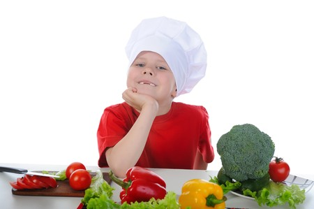 Little chef in the kitchen. Isolated on white background photo