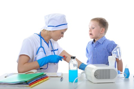doctor showed the boy how to make a shot. Isolated on white background Stock Photo - 6970626