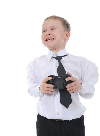 Joyful boy with a joystick in their hands. Isolated on white background photo