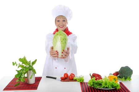 Young chef in the kitchen. Isolated on white background Stock Photo - 6971280