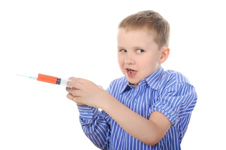 Portrait of a young boy with a syringe. Isolated on white background photo