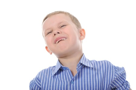Portrait of a happy boy with no teeth. Isolated on white background photo