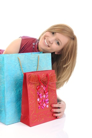 Blonde with a shopping bag. Isolated on white background photo