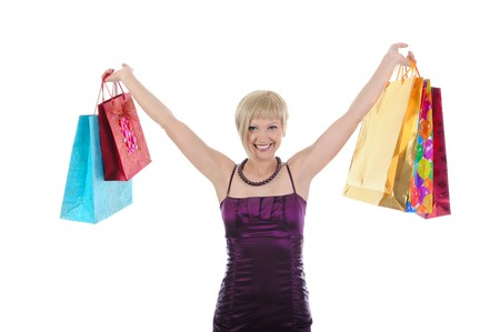 Happy beautiful girl with shopping bags. Isolated on white background photo