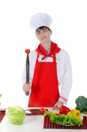 Chef and tomato on the knife. Isolated on white background photo
