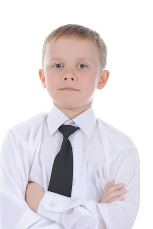 Portrait of a seven year old boy. Isolated on white background photo