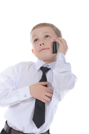 Little boy talking on the phone. Isolated on white background Stock Photo - 7013873
