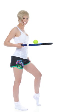 beautiful girl with a tennis racquet. Isolated on white background photo