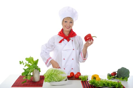 Chef with red pepper in her hand. Isolated on white background photo