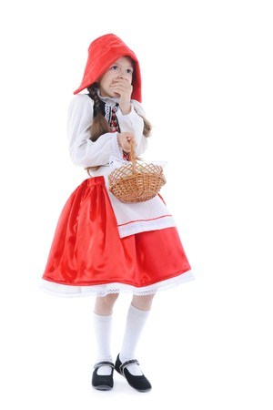 frightened girl in a red cap. Isolated on white background photo