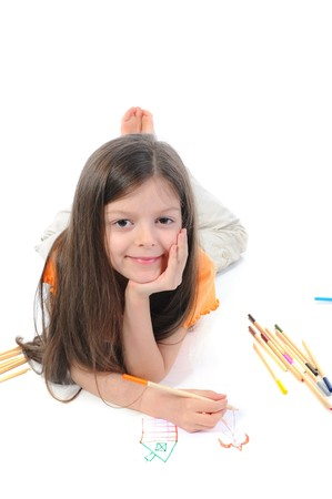 Long-haired little girl draws a princess. Isolated on white background photo
