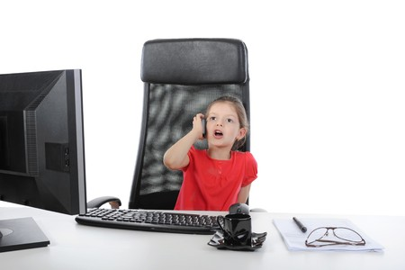little girl in the office talking on the phone. Isolated on white background Stock Photo - 7044752