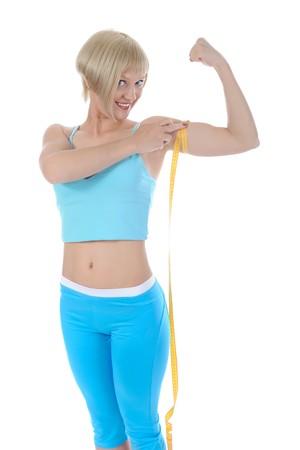 Beautiful athlete measure biceps. Isolated on white background photo