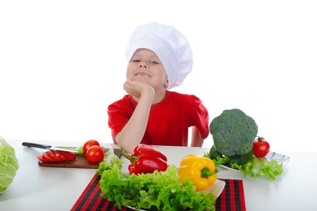 Little Chef in uniform. Isolated on white background Stock Photo - 7044748