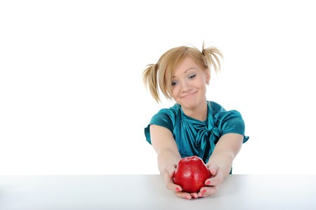Beautiful smiling girl with an apple. Isolated on white background photo