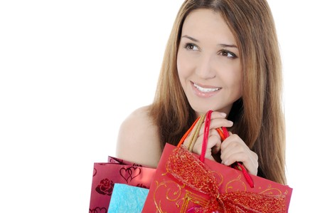 Charming brunette with a shopping bag. Isolated on white background photo