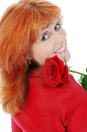 Beautiful red-haired girl with a rose. Isolated on white background Stock Photo - 7086891
