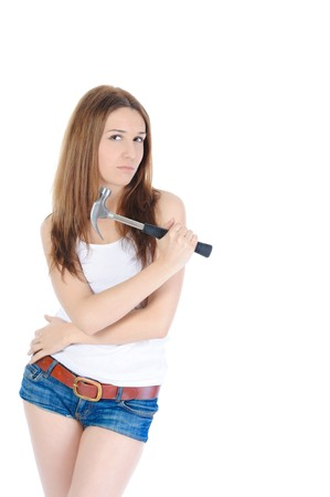 beautiful brunette with a hammer in his hand. Isolated on white background photo