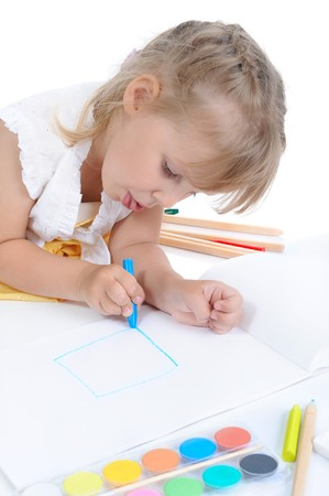 Girl draws on the album. Isolated on white background Stock Photo - 7086898