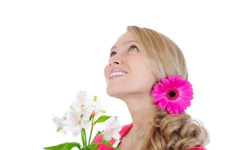 beautiful girl with flowers looking up. Isolated on white background photo