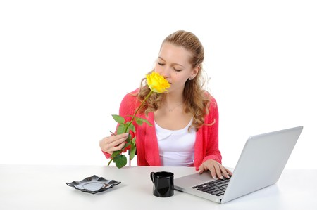 Pretty girl sniffing yellow rose. Isolated on white background photo