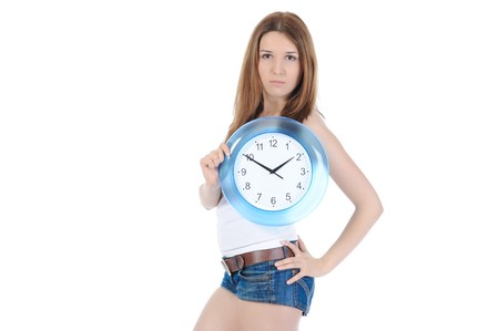 beautiful girl with a clock in his hand. Isolated on white background photo