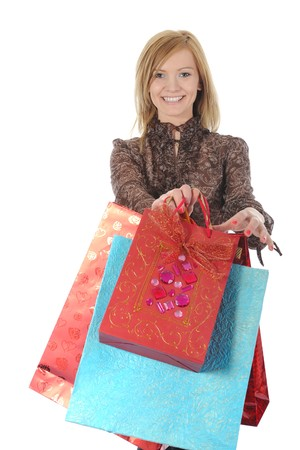 smiling woman with shopping bags. Isolated on white background photo