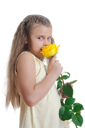 Girl sniffing yellow rose. Isolated on white background Stock Photo - 7124693
