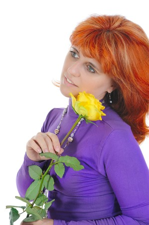 Red-haired woman with a yellow rose. Isolated on white background photo