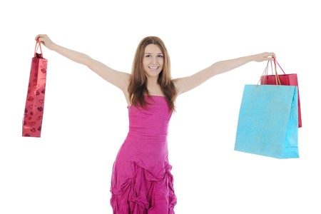 Happy girl with shopping bags. Isolated on white background photo