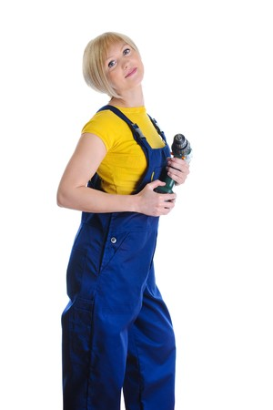 girl with a drill in building overalls. Isolated on white background  photo