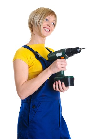 Beautiful blonde with a drill in building overalls. Isolated on white background  photo