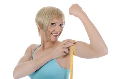 Blonde  athletic girl. Isolated on white background  photo