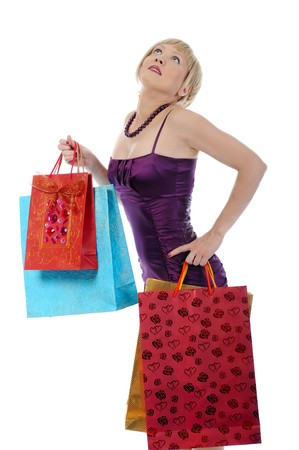 graceful girl with shopping bags. Isolated on white background photo