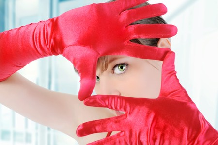 Portrait of a beautiful girl in the red gloves.  photo