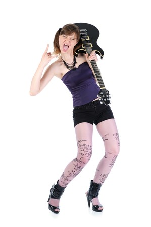 energetic girl with a black guitar in his hand. Isolated on white background photo