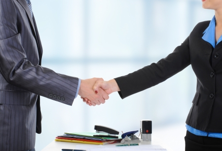 Handshake of business partners, when signing documents.  Stock Photo