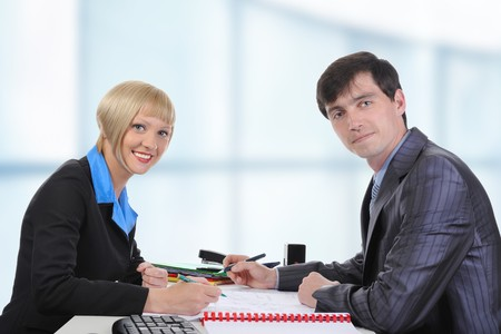 Business man and woman when signing documents.  photo