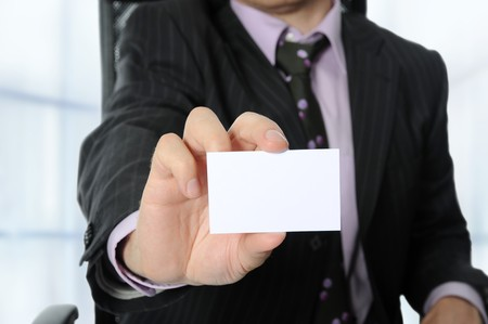 Business man handing a blank business card Stock Photo - 7281180