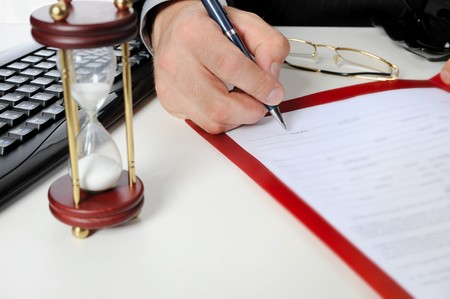 Image of businessman�s hand ready to make signature in a document  photo