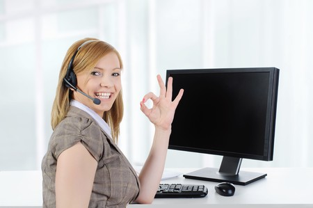 Beautiful girl operator at work in the office. Stock Photo - 7281194