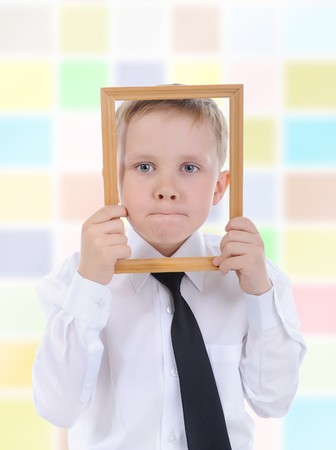 little boy with a wooden frame in his hands. Stock Photo - 7281179
