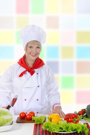 Happy Chef in uniforms preparing a healthy salad. photo