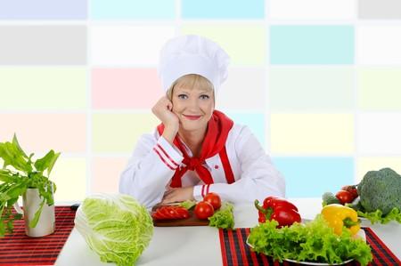 Happy Chef in uniform prepare a healthy breakfast. photo