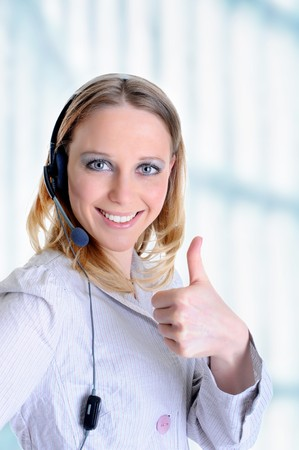 Portrait of a beautiful girl with a headset in the office photo