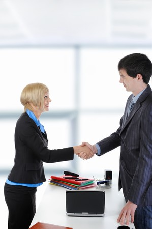 handshake happy business partners in a bright office photo