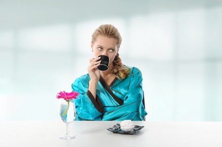 Pretty girl drinking morning coffee with marshmallows. Stock Photo - 7303266