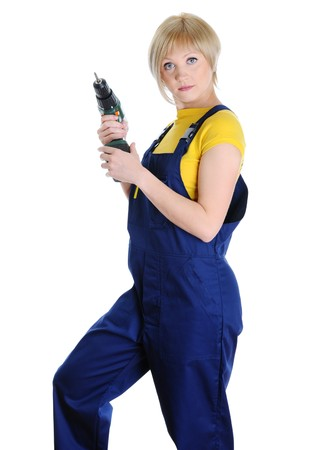 blonde with a drill in building overalls. Isolated on white background  photo