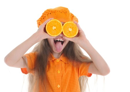 little girl with oranges shows language. Isolated on white background Stock Photo - 7303269